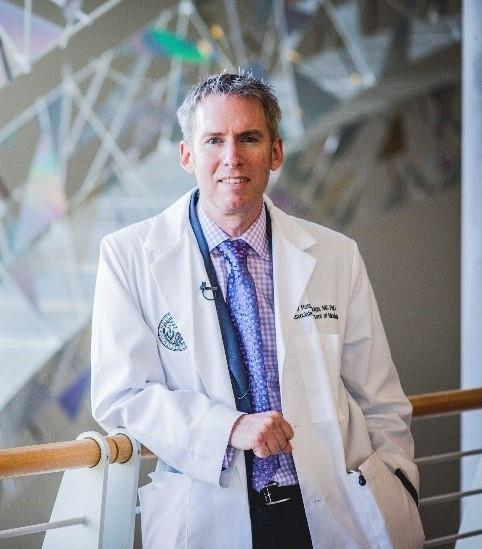 Ross Camidge,  MD, PhD